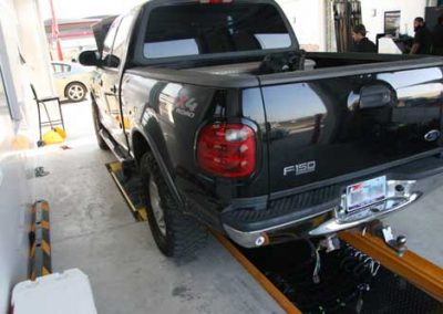 Ford F150 Truck atop of the QuickPit Auto Service Pit System