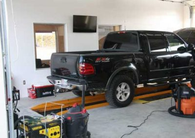 Lube Center Bay showing a Ford F150 in for an Oil Change using the QuickPit Auto Service Pit System