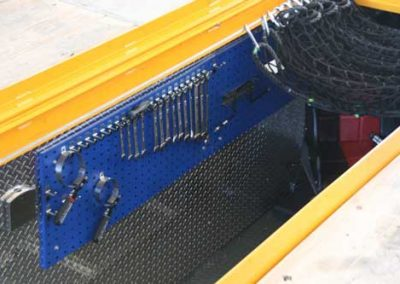 Inside the QuickPit - Blue Pegboard Option on the Left with Net System. Diamond Plate Walls