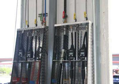 Shinn Buildings 6-Gun Oil Dispensing Cabinet designed to fit between bay doors