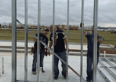 Standing up the first framing panel wall