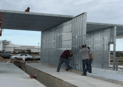 Installing the framing panel atop of the kneewall that separates the lube center from the car wash bay