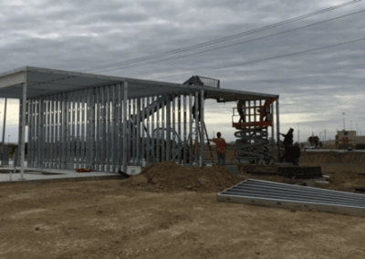 Putting up the framing from a 3-bay lube center with a tunnel car wash